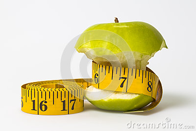 Dieting concept Green apple with measuring tape