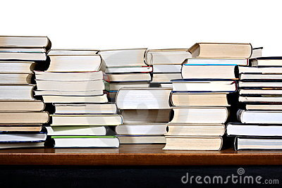 Different books on wooden desk