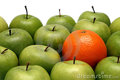 Different concepts - orange between apples