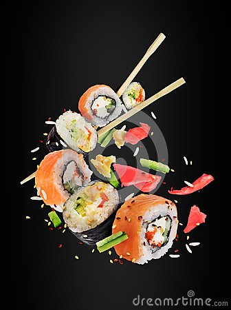 Free Different Fresh Sushi Rolls With Chopsticks Frozen In The Air Stock Image - 116713721