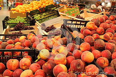 Supermarket stall with fresh peaches