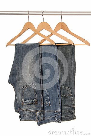 Different  jeans are on hangers.