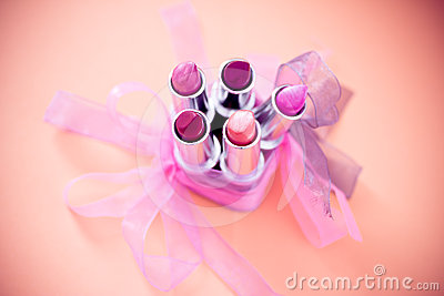 Different lipstick colors with bows and vignette