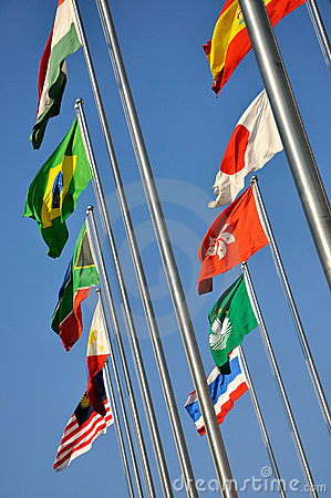 Different national flags under sky