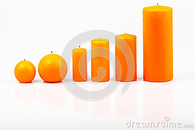 Different sized candles on a white background
