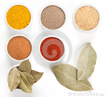 Different spices in bowls isolated on white.