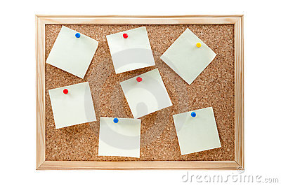 Different sticky notes on a cork board isolated