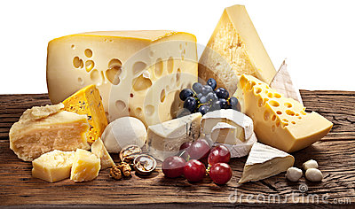 Different types of cheese over old wooden table. Stock Photo