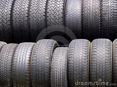 Two rows of used tires in diffused light