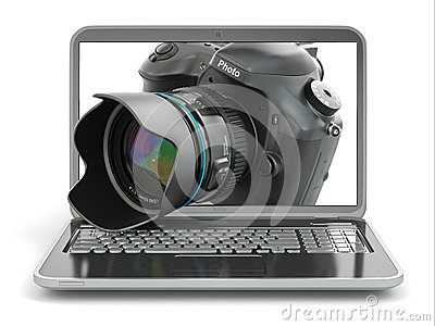 Digital photo camera and laptop. Journalist  or  traveler equipm