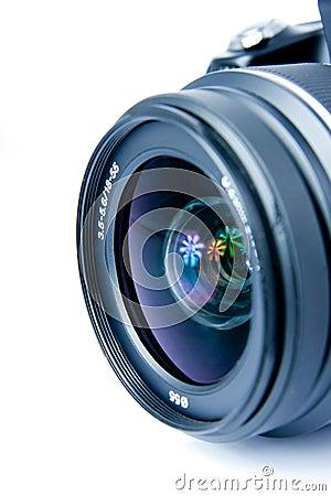Digital photo camera, lens, closeup, isolated