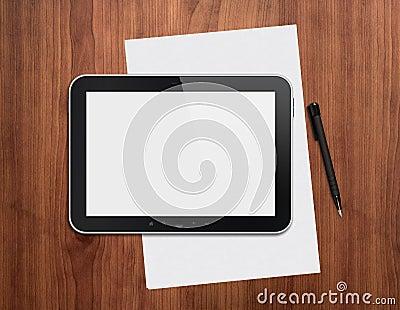 Digital tablet with pen on a desktop
