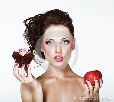 Free Dilemma. Diet. Undecided Woman With Apple And Cupcake Stock Photo - 33963780
