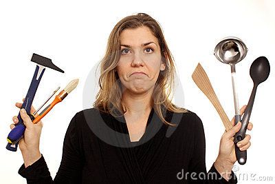 Dilemma, woman hesitating between tools or kitchen