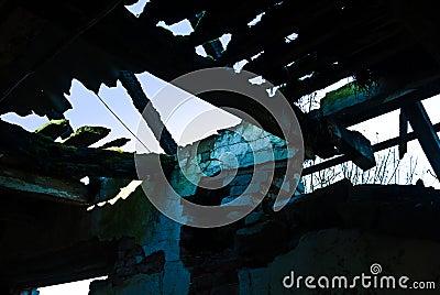 Dimly-lit dilapidated barn