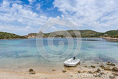 Dinghy at bautiful island bay beach