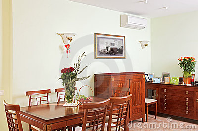 Dining room interior with classic wooden furniture