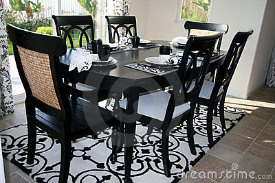 done in trendy black and white dining table is on a white and black