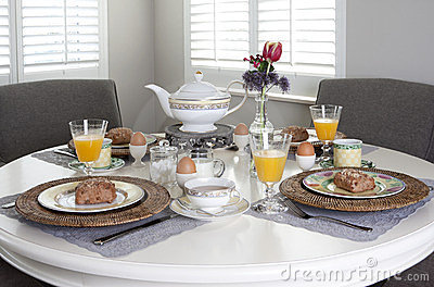 Dining table laid for breakfast