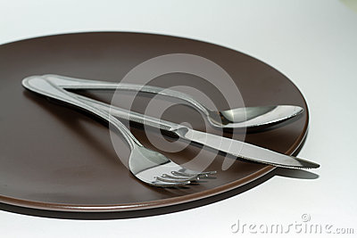Dinner plate with knife, fork, and spoon