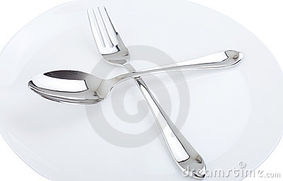 Dinner plate, spoon and fork.