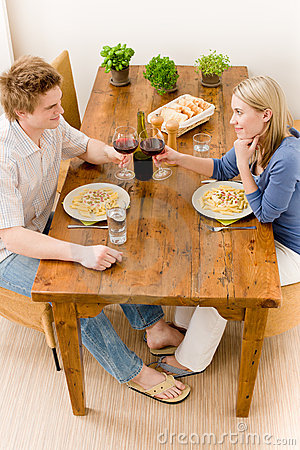 Dinner romantic couple enjoy wine eat pasta