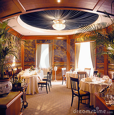 Dinner will be served soon in a luxury dining-room
