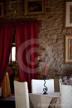 Dinning Room With Red Candle