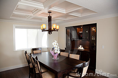 Dinning room with wood table and wood cabinets