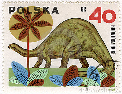 Dinosaur (brontosaurus) on a vintage post stamp