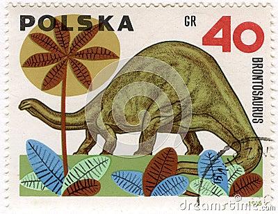 Dinosaur (brontosaurus) on a vintage post stamp