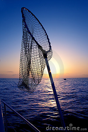 Dip net in boat fishing on sunrise saltwater