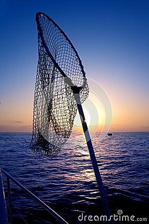 Dip net in boat fishing on sunrise saltwater