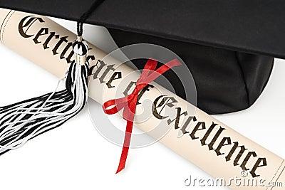 Diploma and graduation cap
