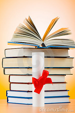 Diploma and stack of books