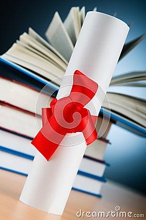 Diploma y pila de libros
