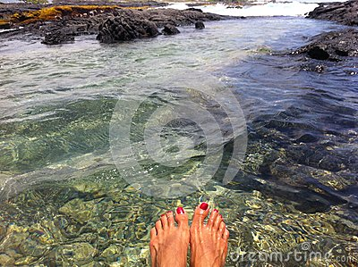 Dipping feet in tide pool in Hawaii