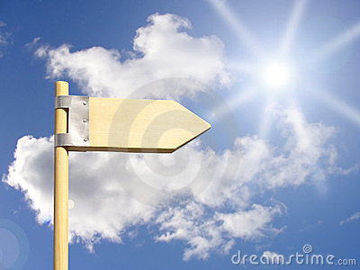 Direction sign under sun