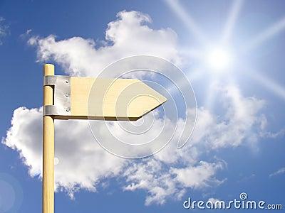 Direction sign under sun