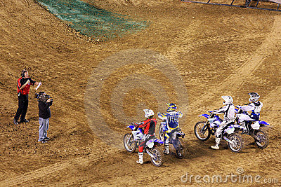 Dirt bikes line up at starting line Editorial Image