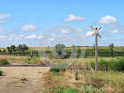 Dirt road and prairie railroad crossing