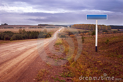Dirt road and road sign