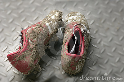 Dirty Football Or Soccer Boots Royalty Free Stock Photo