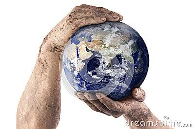 Dirty gardener hands holding world