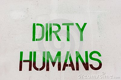 Dirty humans written on white wall