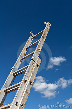 Dirty ladder pointing to the sky