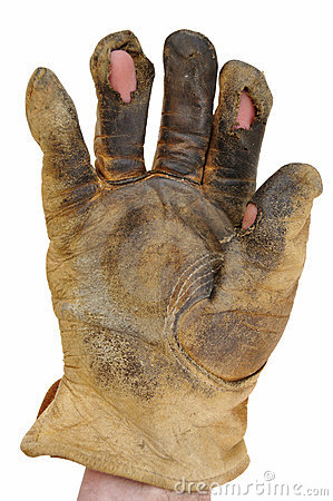 Dirty Leather Work Glove With Holes Stock Photography