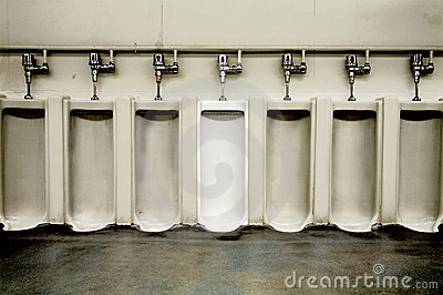 Dirty men s bathroom with one clean urinal