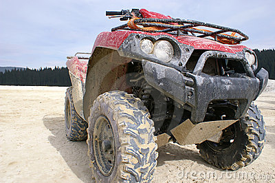 Dirty red ATV