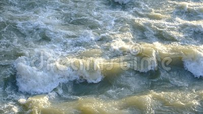Dirty water in the city. High quality video of dirty water: you may see strong water flow, lots of dirty foam, power of water, deep gray with green color, good stock video footage